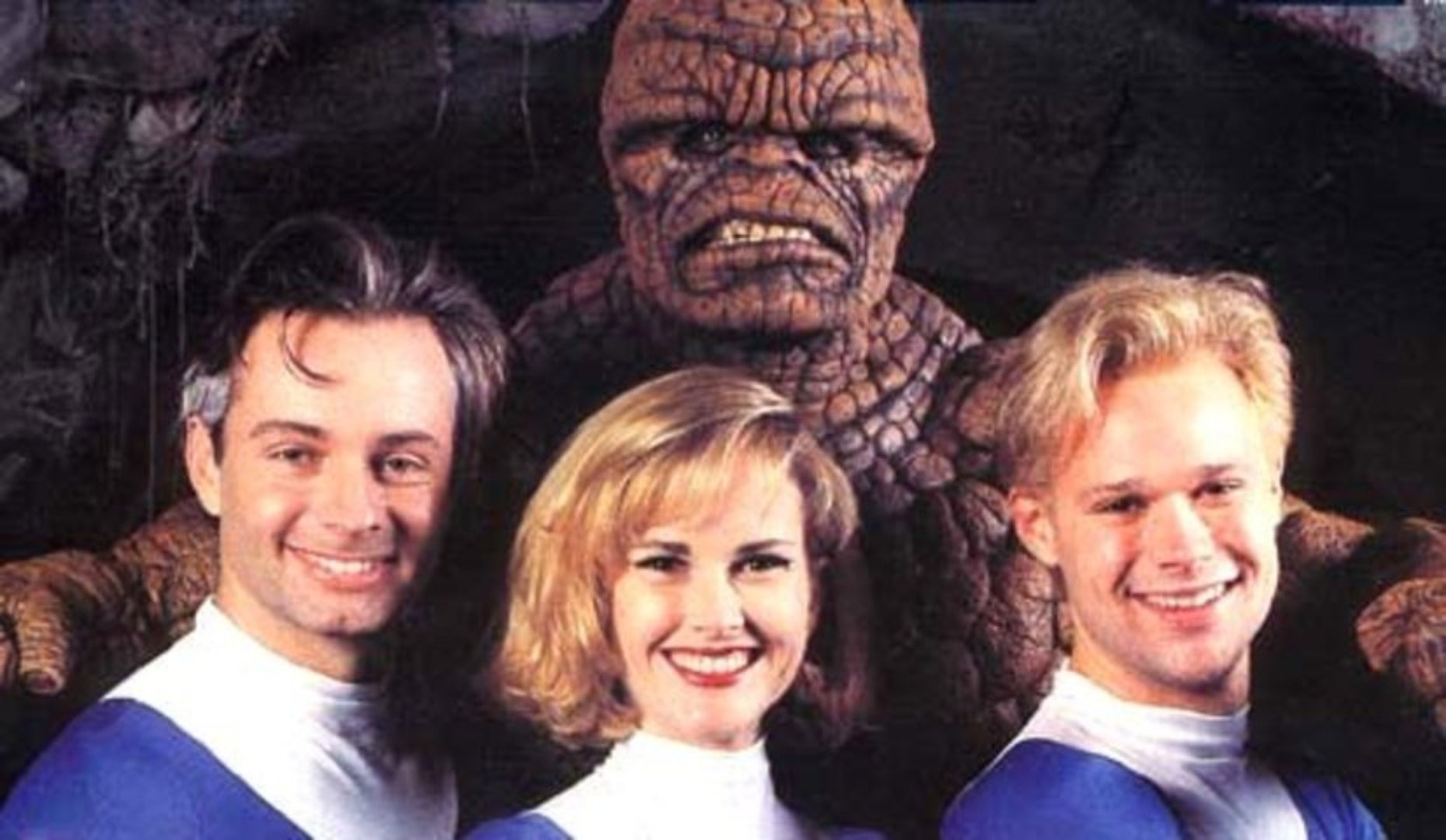 Alex Hyde-White as Reed Richards, Rebecca Staab as Susan Storm, Jay Underwood as Johnny Storm, and Carl Ciarfalio as Ben Grimm in The Fantastic Four (1994)