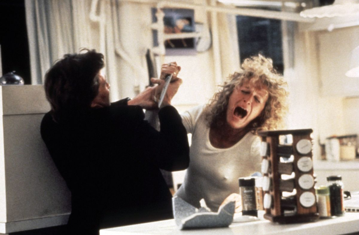 Michael Douglas fends off a knife-wielding Glenn Close in the family bathroom in Fatal Attraction (1987)