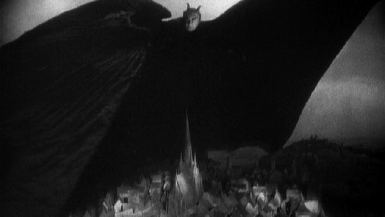 Mephisto's shadow stretches over the town in Faust (1926)