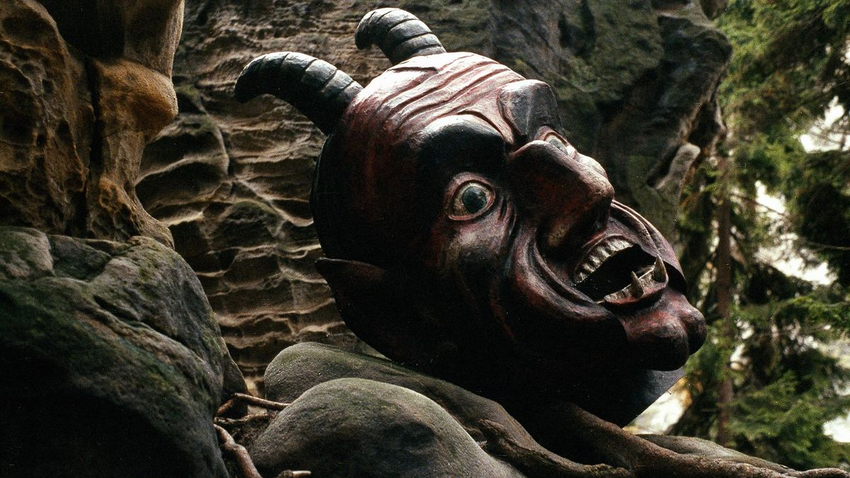 The giant stone Devil's head in Faust (1994)