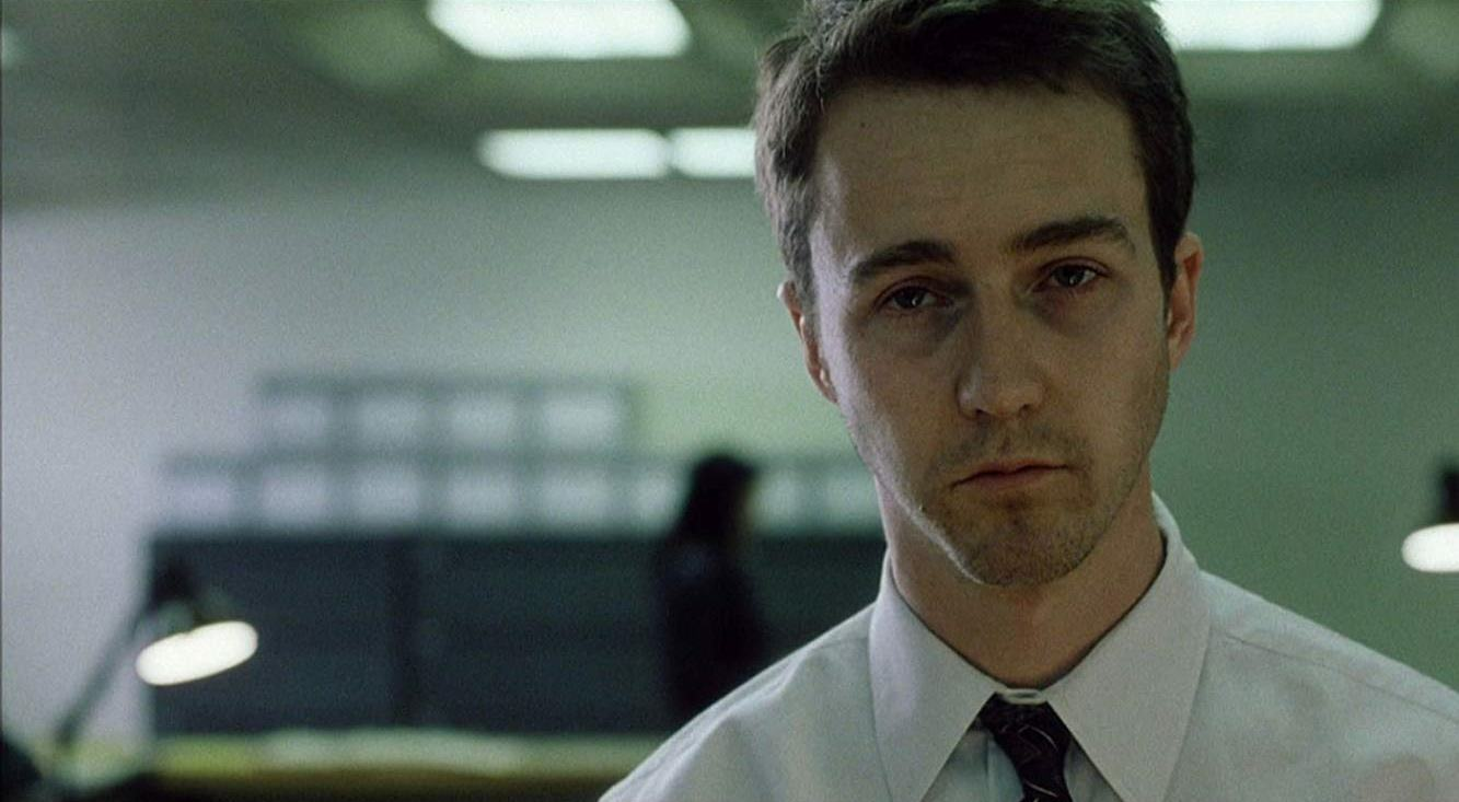 Edward Norton trapped in a meaningless consumer lifestyle in Fight Club (1999)