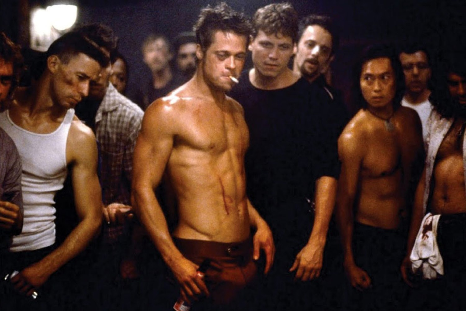 A bare-chested Brad Pitt sets out to brawl in Fight Club (1999)