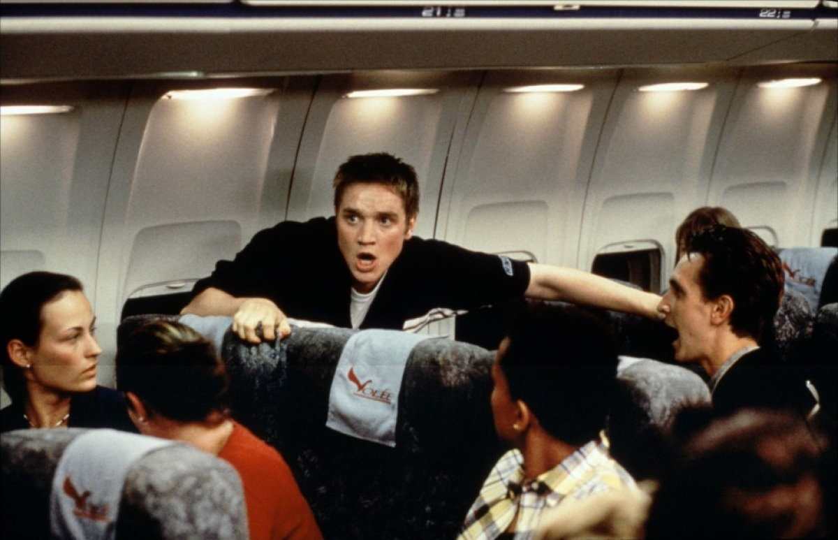 Devon Sawa panics aboard the flight after having a vision of the plane crashing in Final Destination (2000)