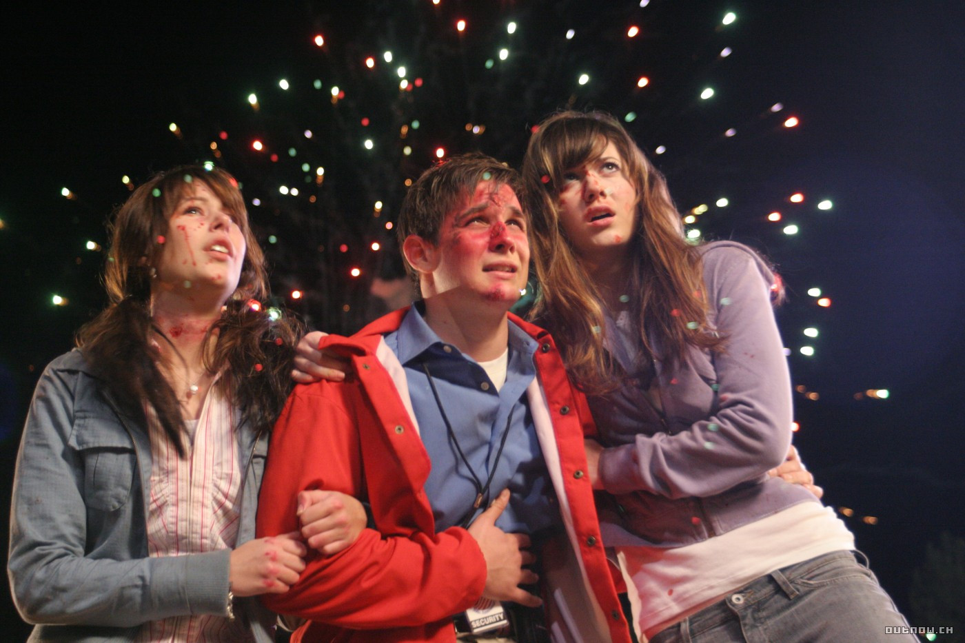 Amanda Crew, Ryan Merriman and Mary Elizabeth Winstead pick themselves up in the aftermath of a rollercoaster accident in Final Destination 3 (2006)