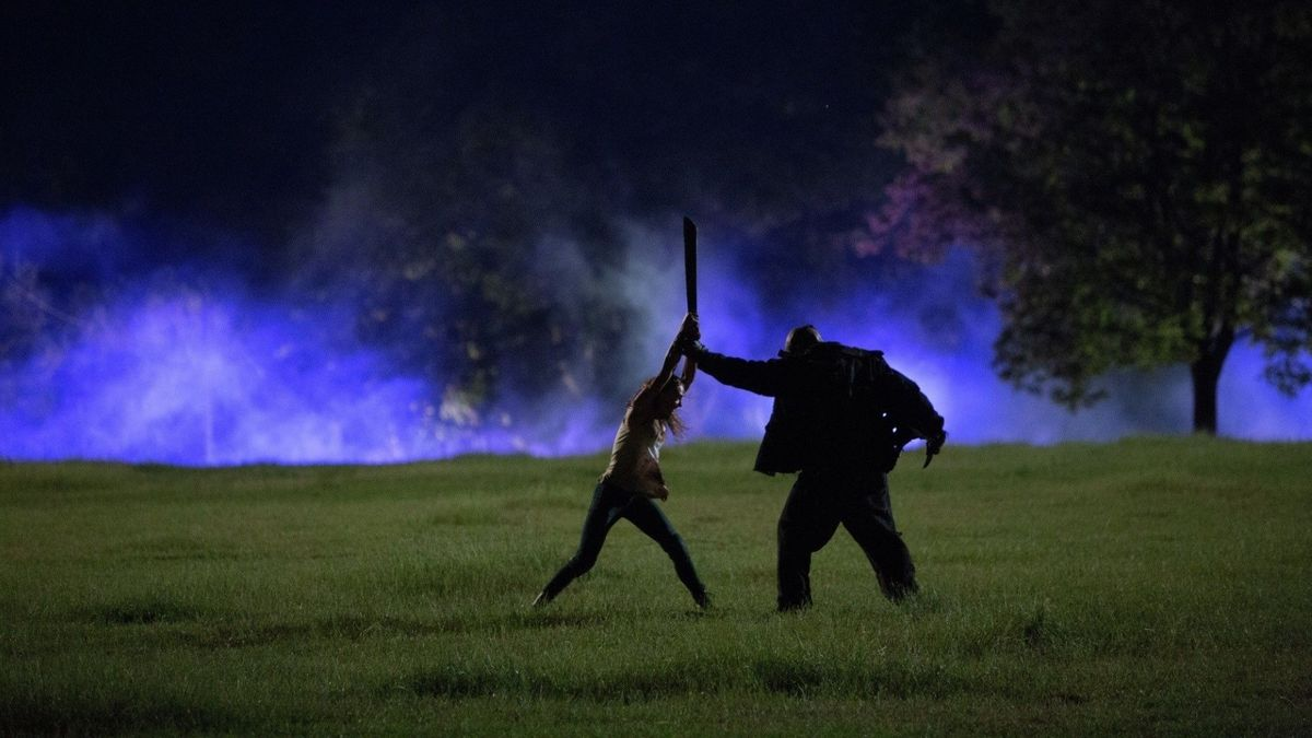 Taissa Farmiga faces down against hockey-masked killer Billy Murphy (Daniel Norris) in The Final Girls (2015)