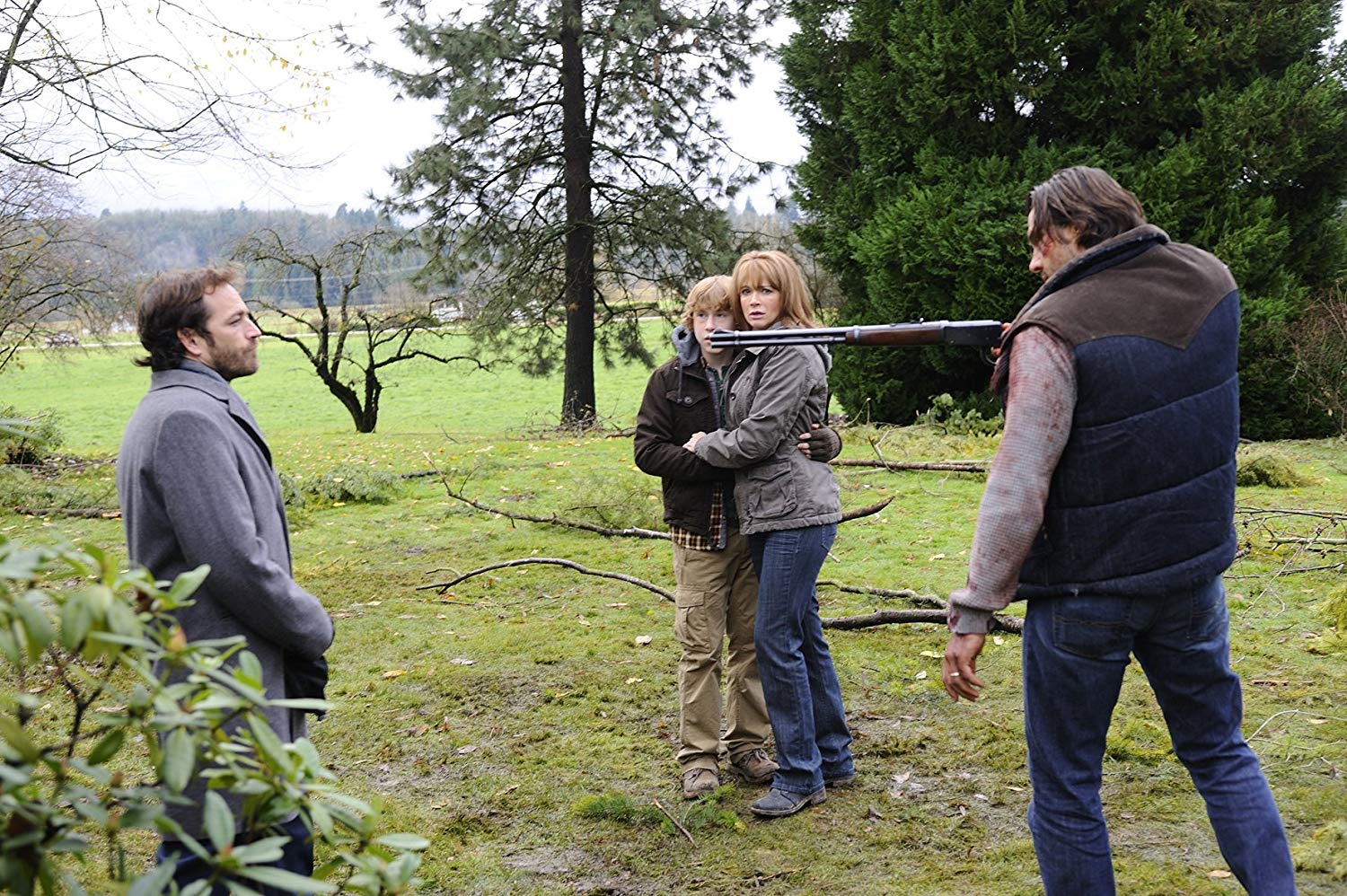 (l to r) Mysterious stranger Luke Perry, son Cole Heppell, wife Lauren Holly and husband Steve Bacic in The Final Storm (2010)