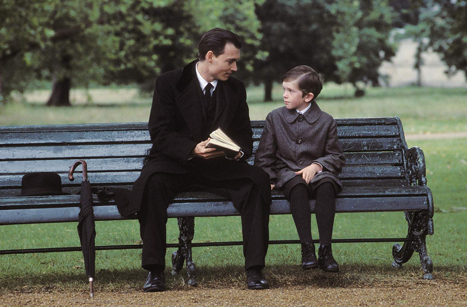 Johnny Depp as J.M. Barrie with Freddie Highmore as Peter Llewelyn Davies in Finding Neverland (2004)