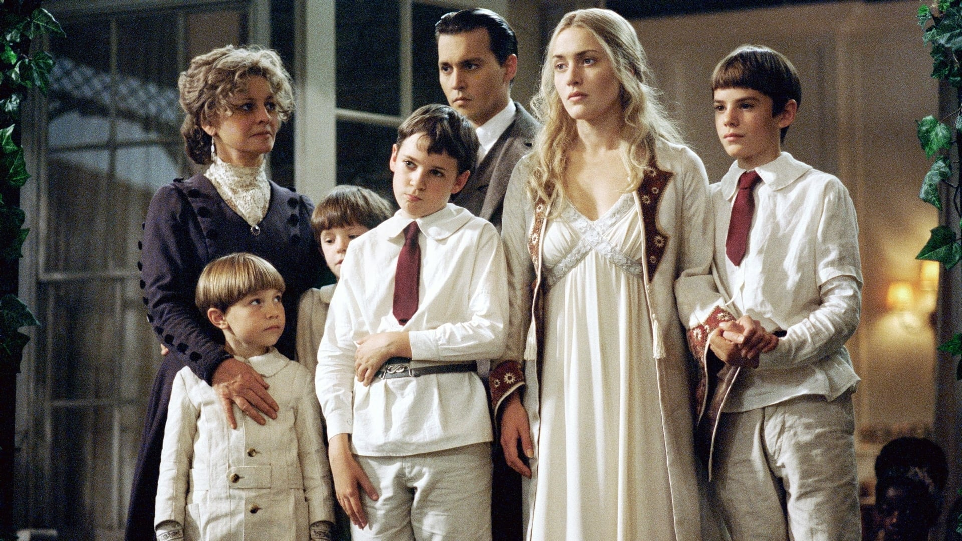 Johnny Depp and Kate Winslet surrounded by the Llewellyn Davies children with Julie Christie in Finding Neverland (2004)