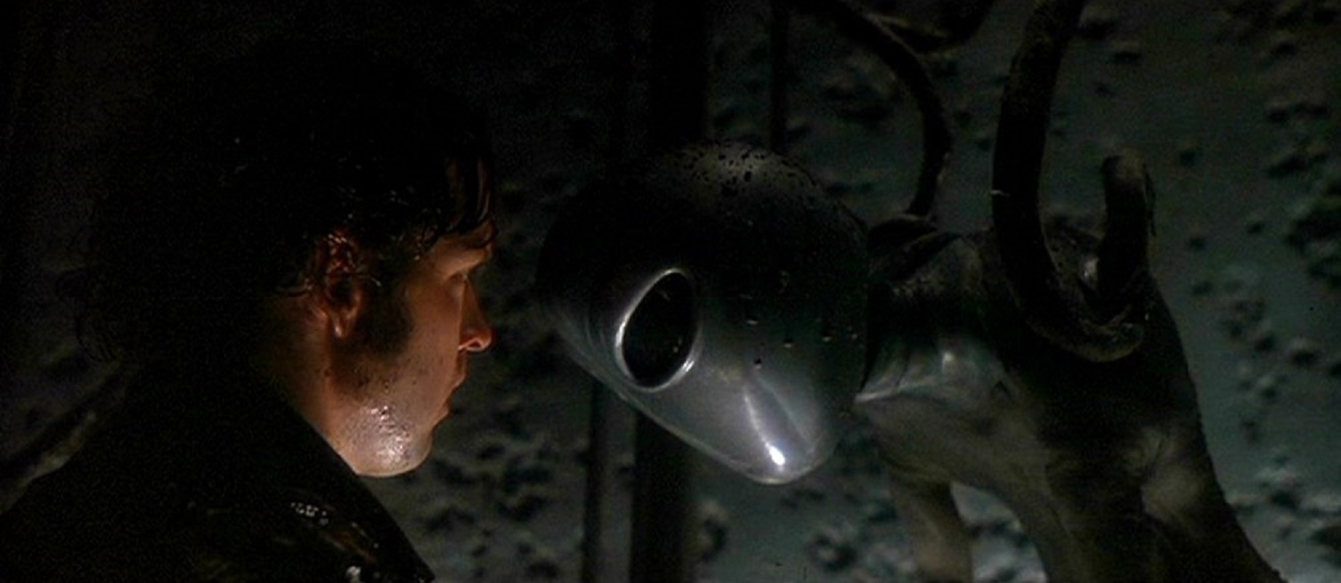 Travis Walton (D.B. Sweeney) encounters an alien in Fire in the Sky (1993)