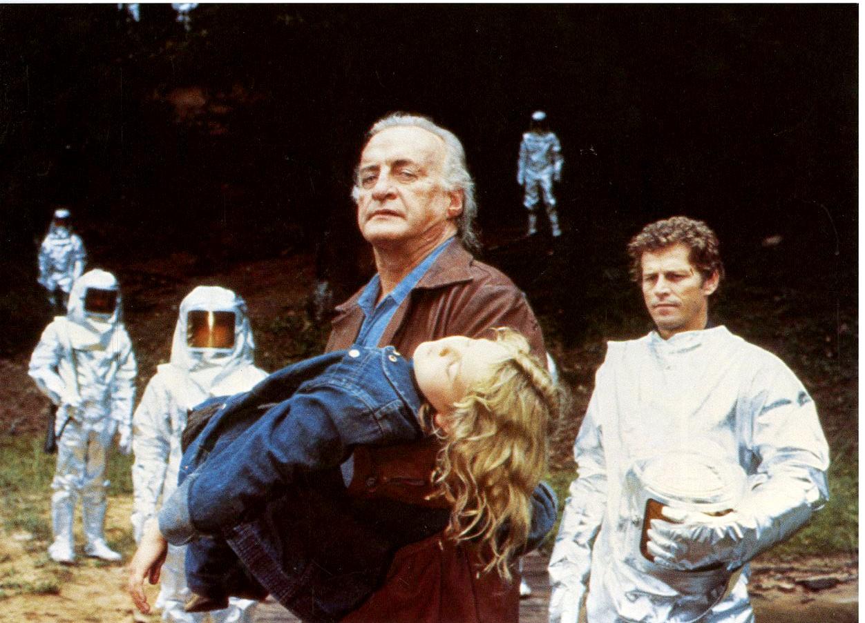 Rainbird (George C. Scott) carries an unconscious Drew Barrymore away in Firestarter (1984)