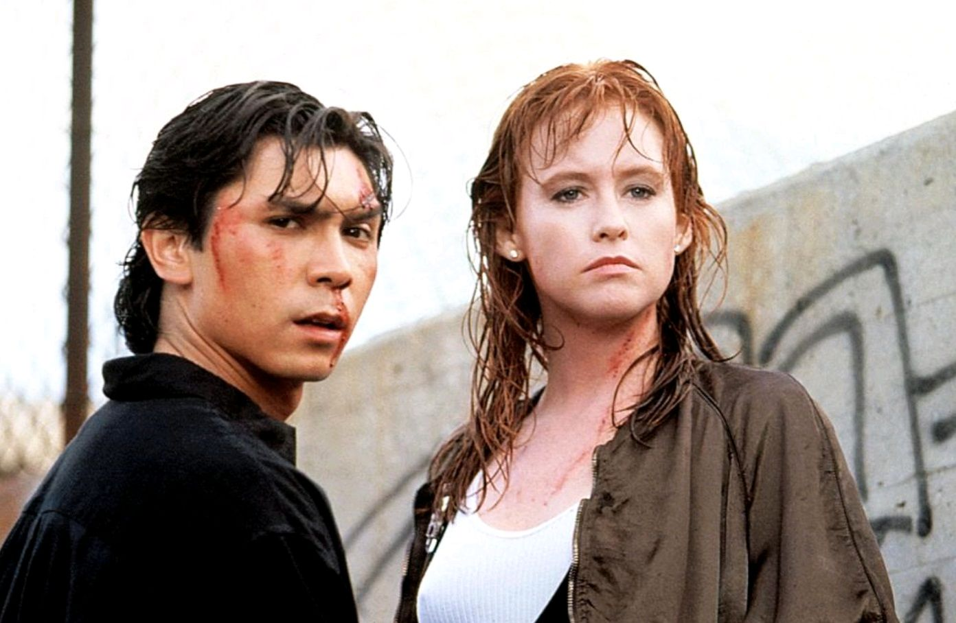 Lou Diamond Phillips and Tracy Griffith in The First Power (1990)