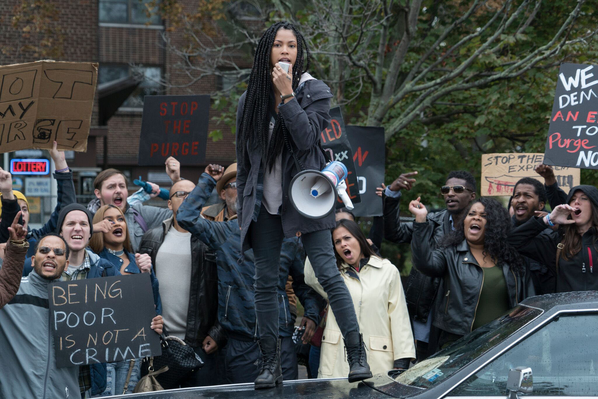 Nya (lex Scott Davis) leads the protests - a Purge film for the era of Black Lives Matter - The First Purge (2018)