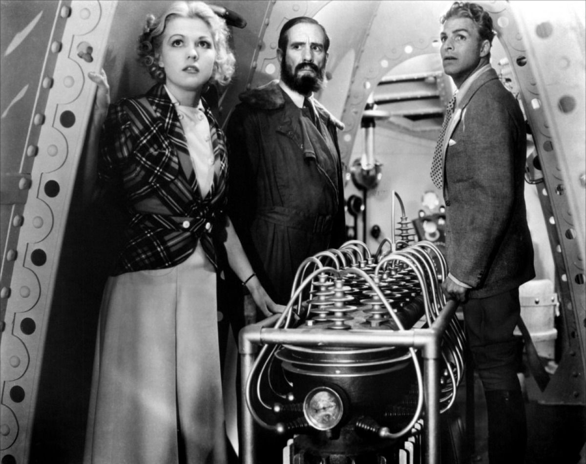 (l to r) Dale Arden (Jean Rogers), Dr Zarkov (Frank Shannon) and Flash Gordon (Larry 'Buster' Crabbe) in Flash Gordon (1936)