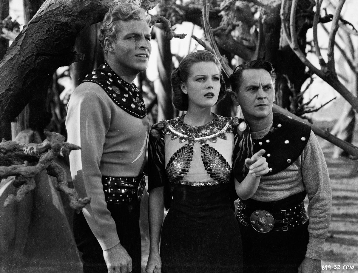 (l to r) Flash Gordon (Larry 'Buster' Crabbe), Dale Arden (Jean Rogers) and comic relief Happy Hapgood (Donald Kerr) in Flash Gordon's Trip to Mars (1938)