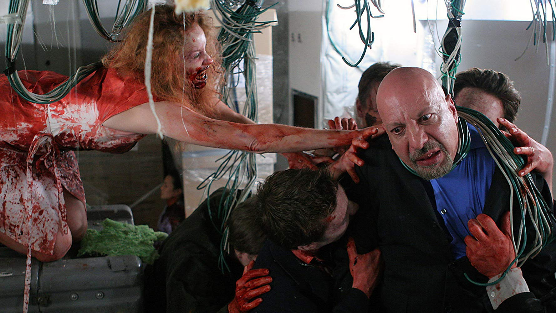 Erick Avari is attacked by zombies on a plane in Flight of the Living Dead: Outbreak on a Plane (2007)