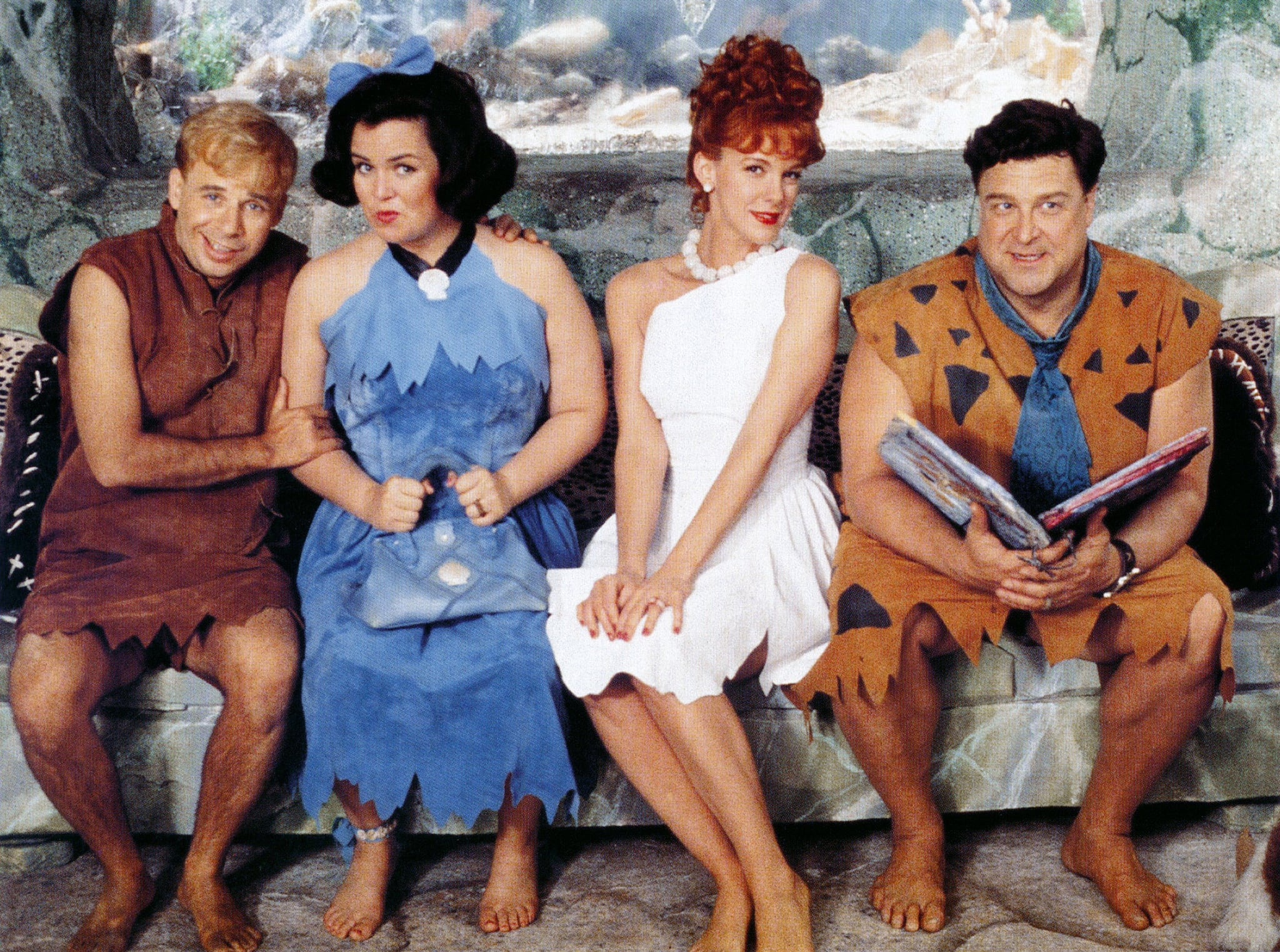 Barney and Betty Rubble (Rick Moranis and Rosie O'Donnell) and Wilma and Fred Flintstone (Elizabeth Perkins and John Goodman) in The Flintstones (1994)