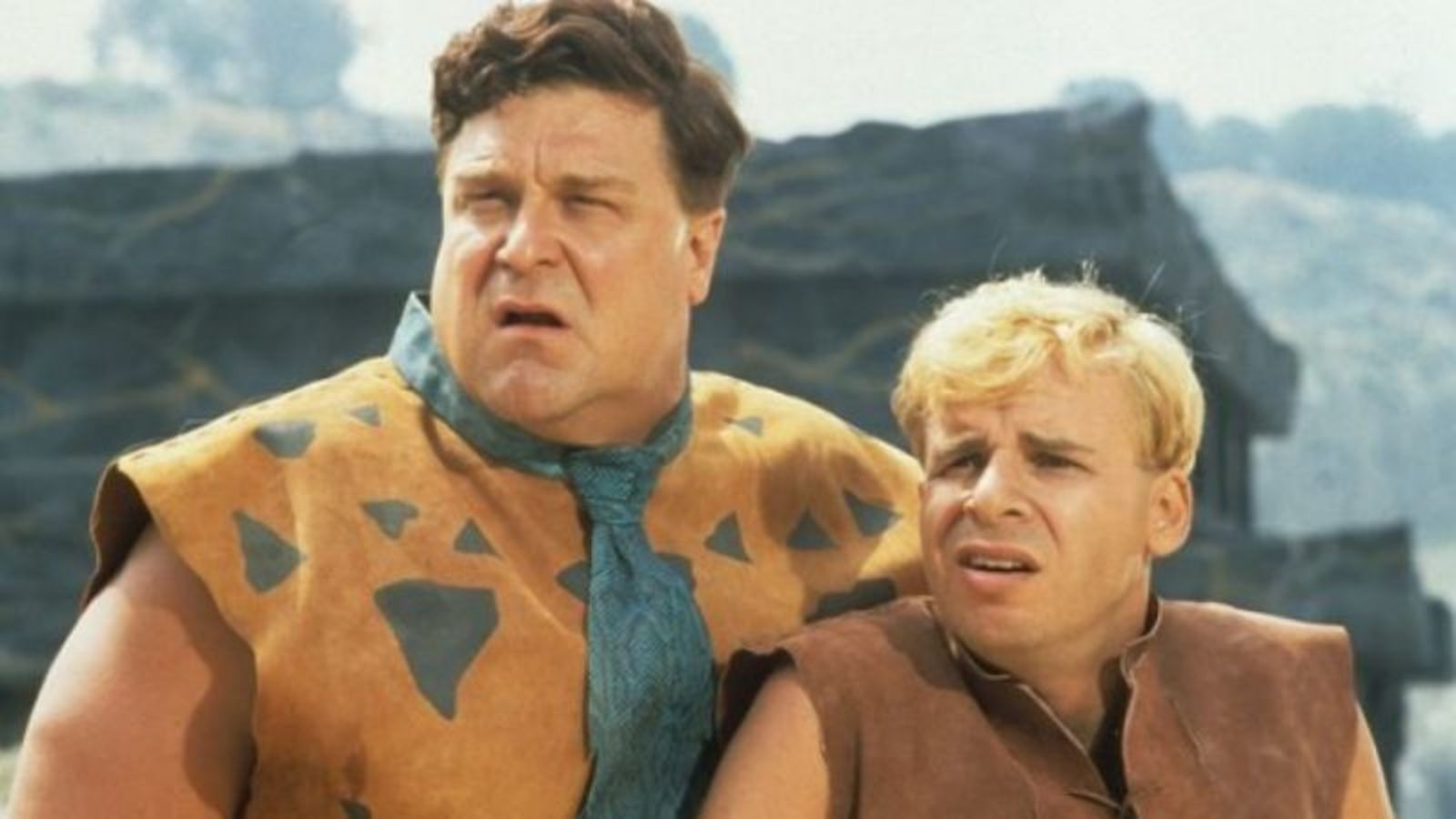 Best friends and co-workers - Fred Flintstone (John Goodman) and Barney Rubble (Rick Moranis) in The Flintstones (1994)