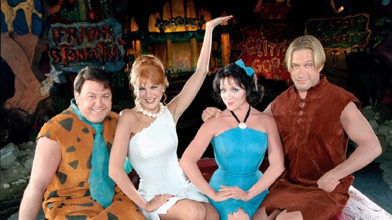 Fred Flintstone (Mark Addy), Wilma Flintstone (Kristen Johnston), Betty Rubble (Jane Krakowski) and Barney Rubble (Stephen Baldwin) in The Flintstones in Viva Rock Vegas (2000)