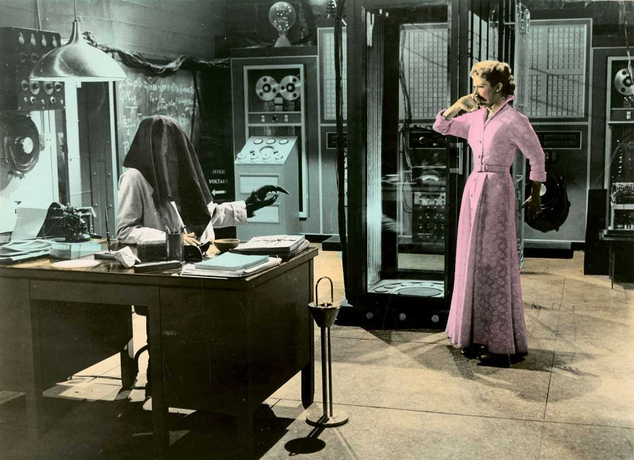 Patricia Owens meets husband Al Hedison in the laboratory after the teleporter accident in The Fly (1958)