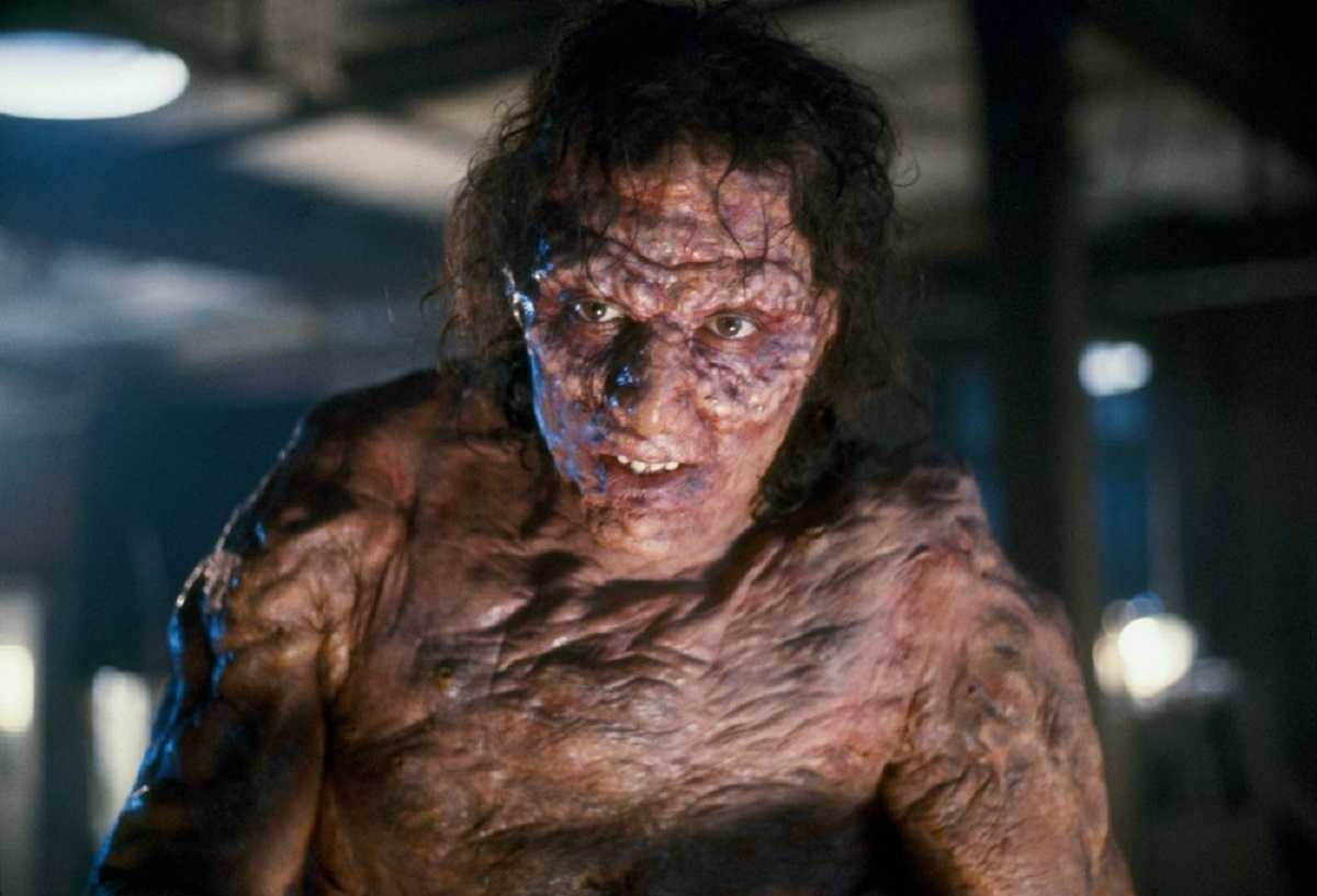 Seth Brundle (Jeff Goldblum) starts to mutate into a fly hybrid in The Fly (1986)