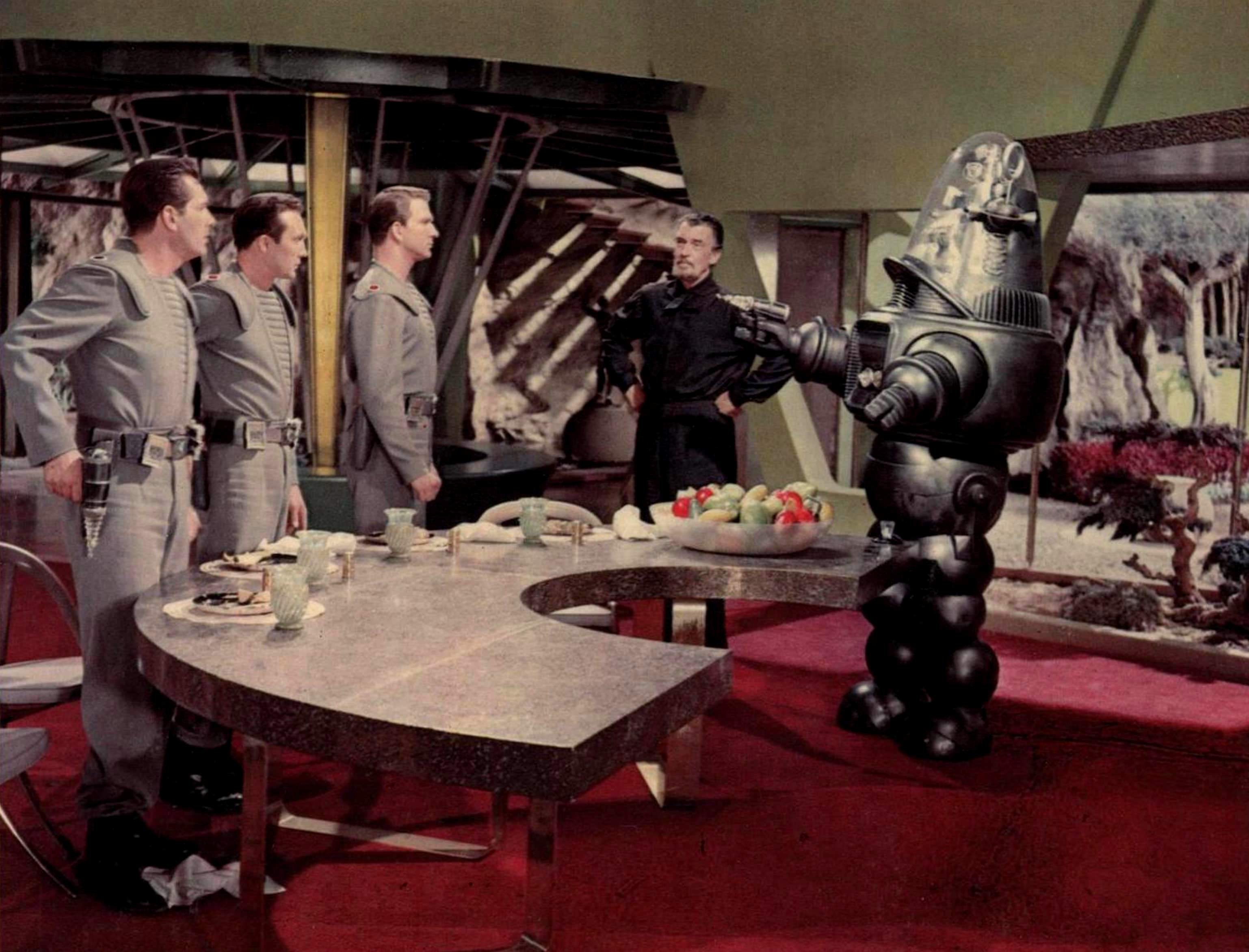 The Earth visitors - Jack Kelly, Warren Stevens, Leslie Nielsen - meet Dr Morbius (Walter Pidgeon) and Robby the Robot in Forbidden Planet (1956)