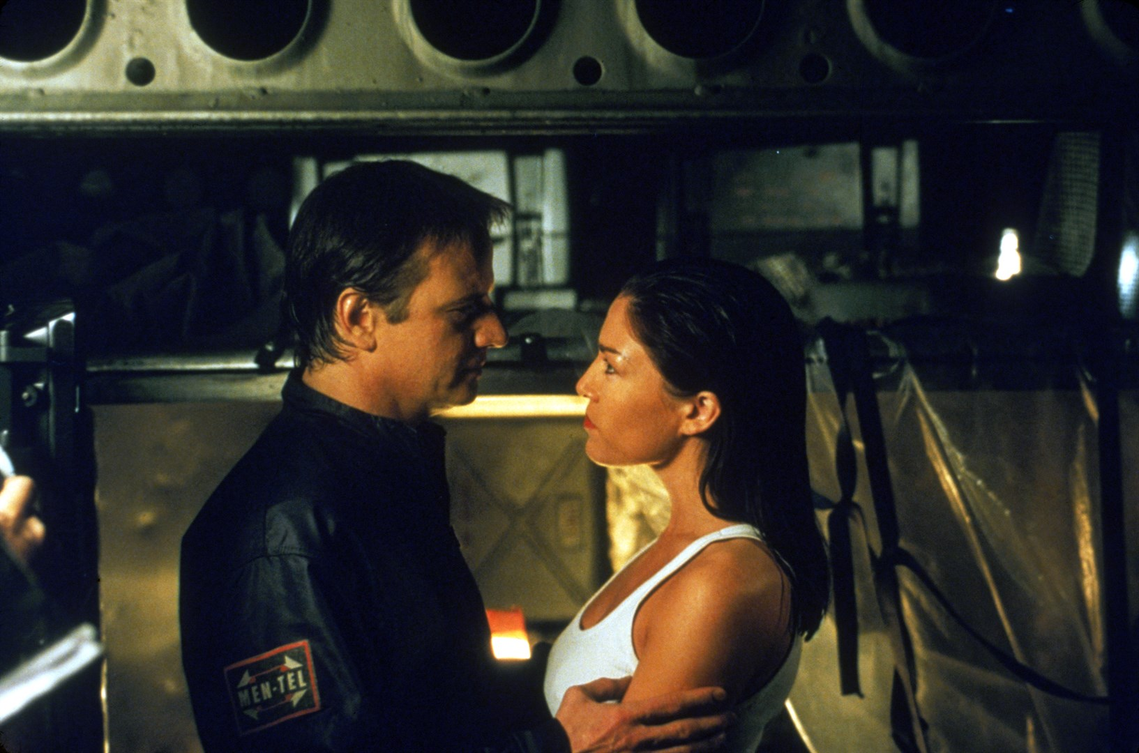 John Brennick (Christopher Lambert) sentenced to prison in orbit along with fellow inmate Liz May Brice in Fortress 2: Re-Entry (2000)