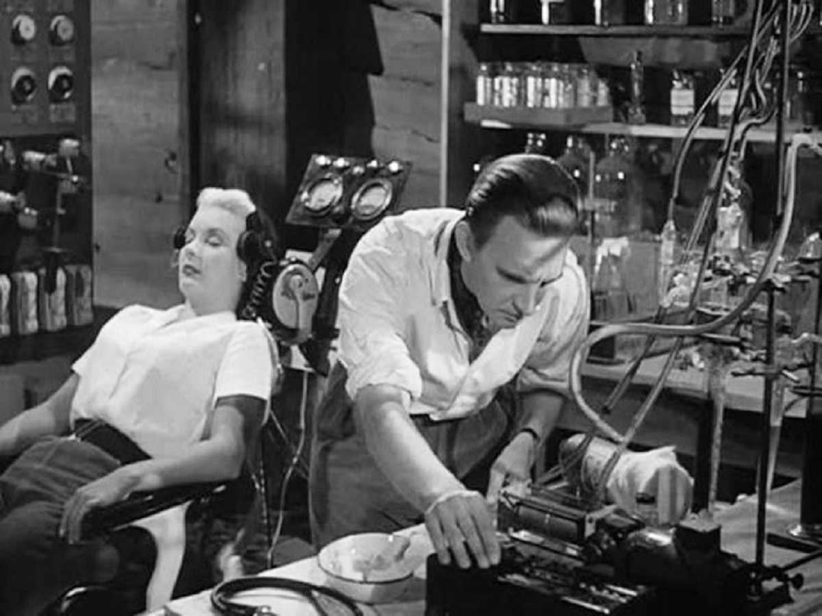 Stephen Murray prepares to make a copy of Barbara Payton in Four Sided Triangle (1953)