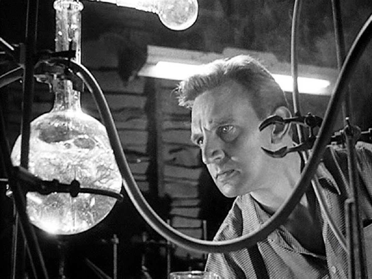 Stephen Murray obsessively tries to perfect the matter duplication machine in Four Sided Triangle (1953)
