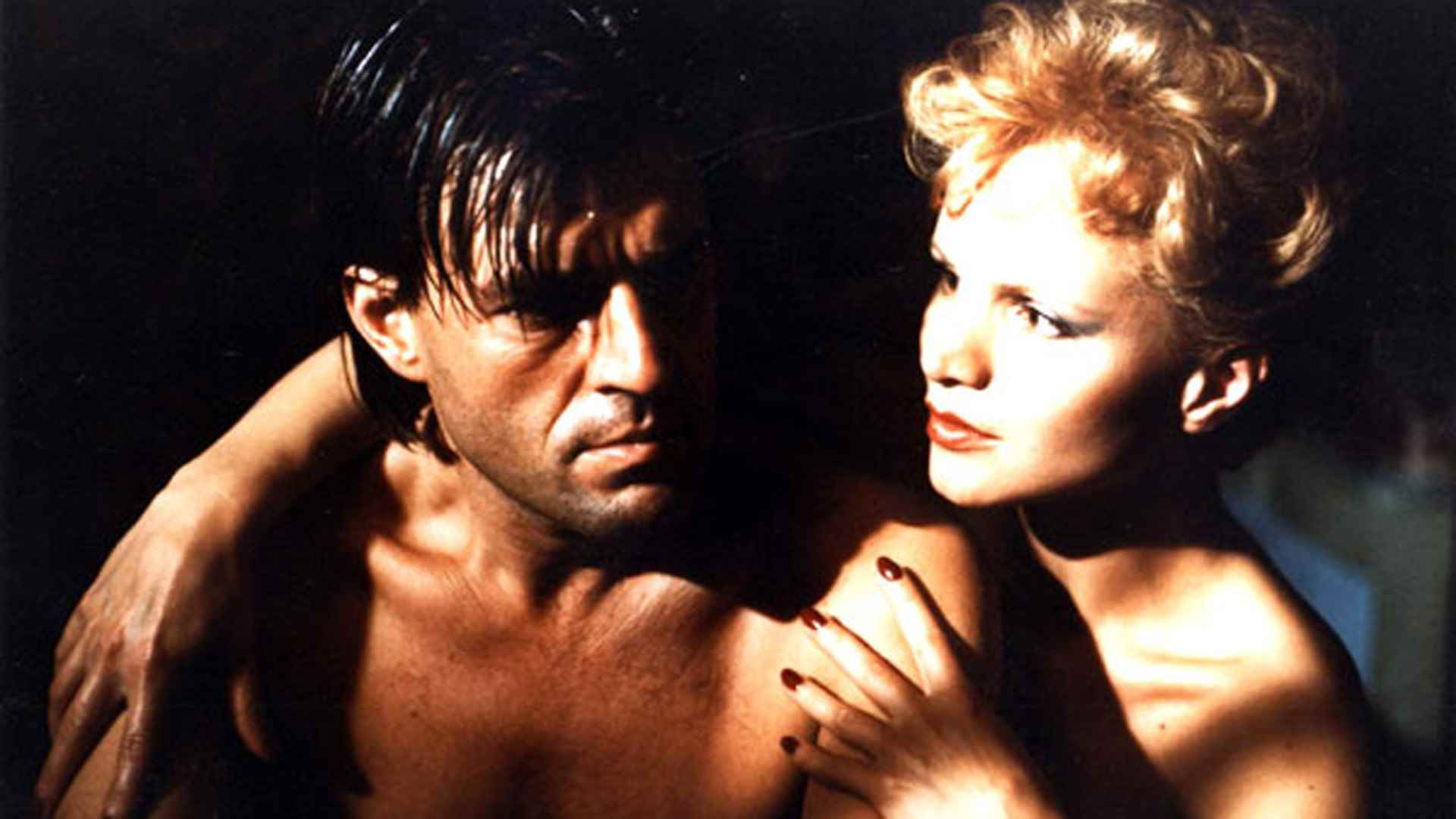 Gay writer Jeroen Krabbe in the arms of femme fatale Renee Soutendijk in The Fourth Man (1983)