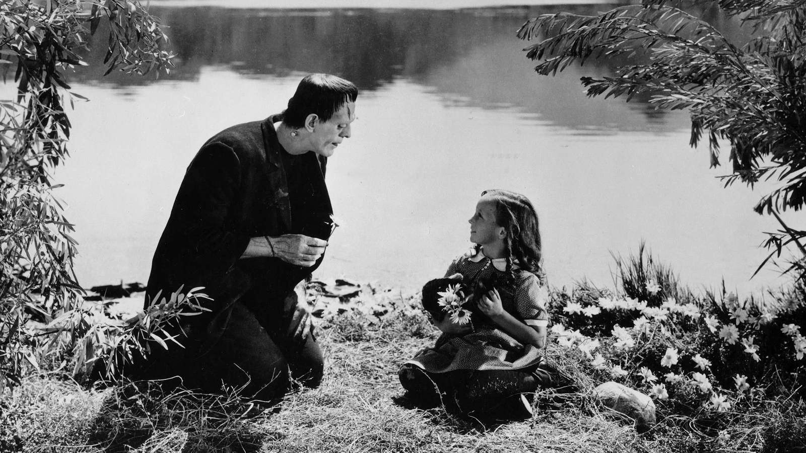 Boris Karloff's Monster meets the little girl picking flowers on the riverbank in Frankenstein (1931)