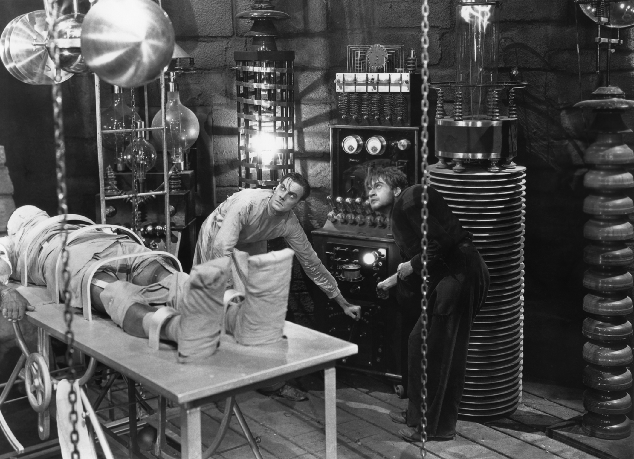 Colin Clive as Frankenstein and Dwight Frye as Friz, the original hunchback lab assistant, in Frankenstein (1931)