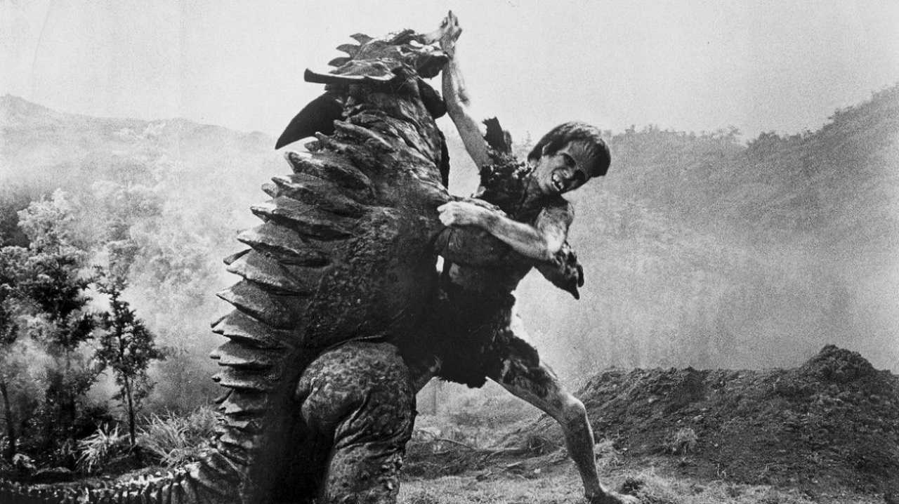 The giant-size Frankenstein boy (Kuji Furuhata) wrestles with Baragon in Frankenstein Conquers the World (1966)