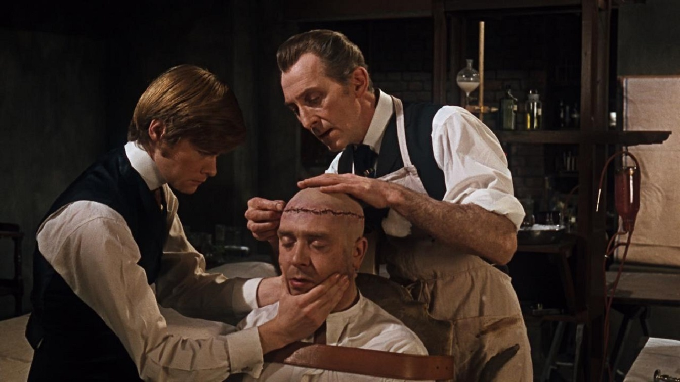 Frankenstein (Peter Cushing) (r) assisted by Simon Ward (l) prepares to operate on Freddie Jones (c) in Frankenstein Must Be Destroyed (1969)