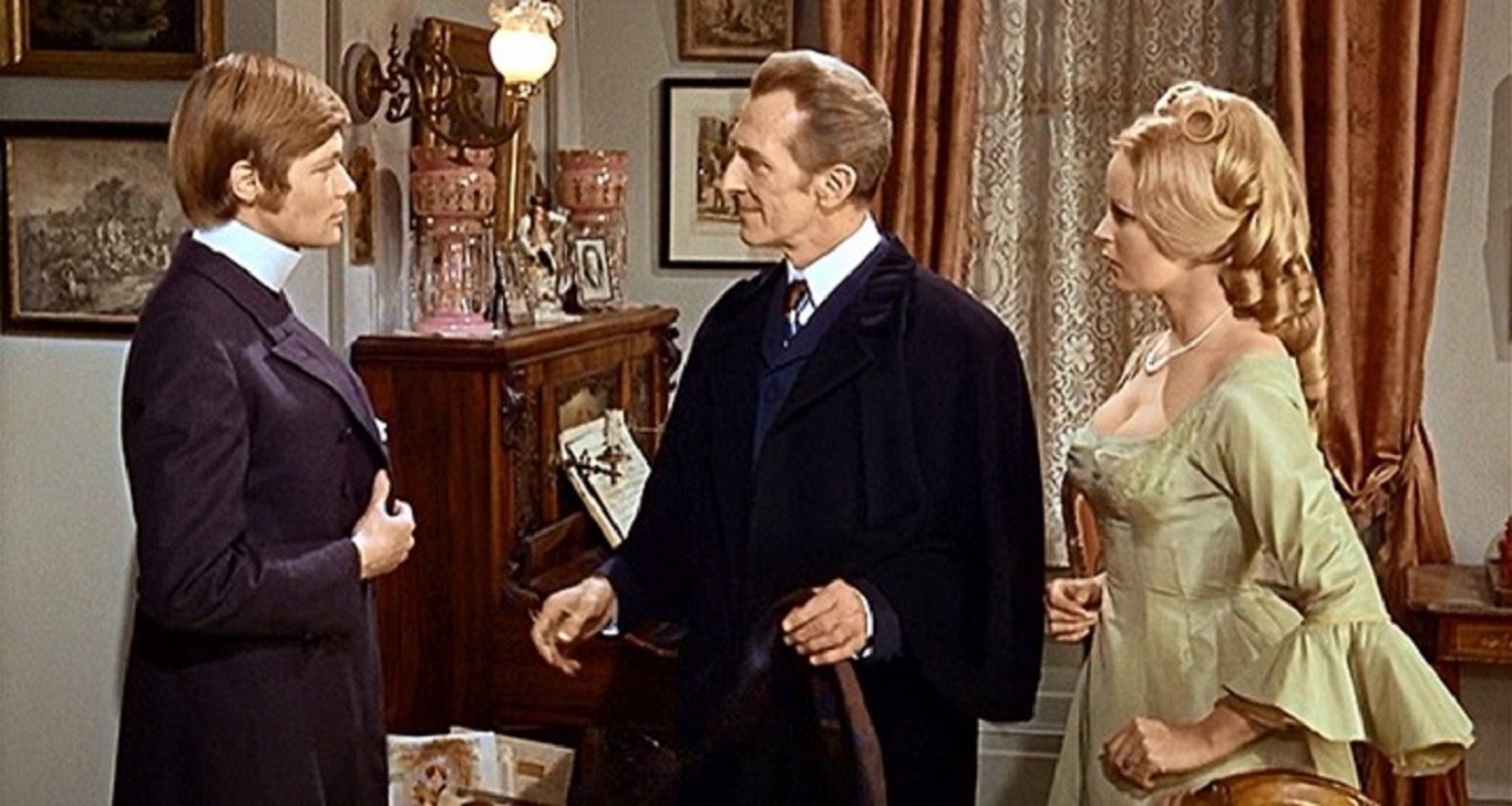 Baron Frankenstein (Peter Cushing) (c) signs in to the boarding house of Veronica Carlson (r) and her fiance Simon Ward (l) in Frankenstein Must Be Destroyed (1969)