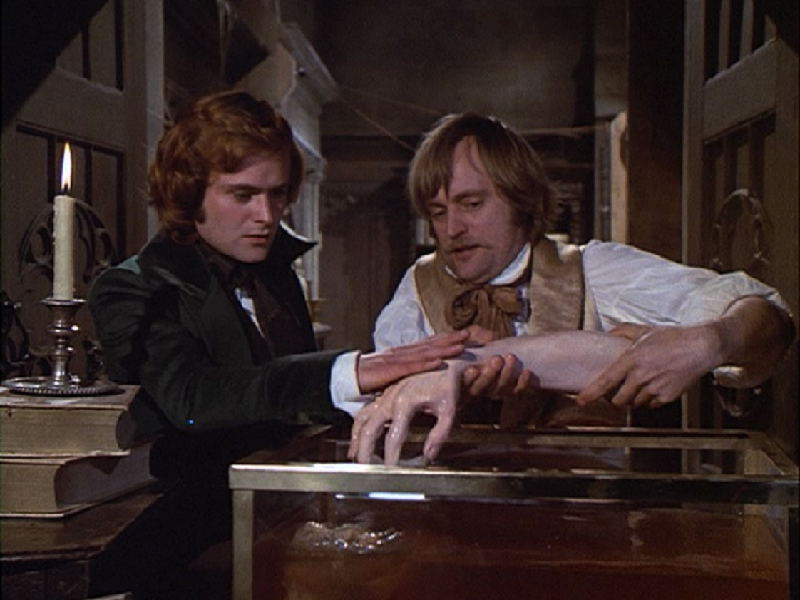 Victor Frankenstein (Leonard Whiting) and Henry Clerval (David McCallum) in the laboratory in Frankenstein: The True Story (1974)