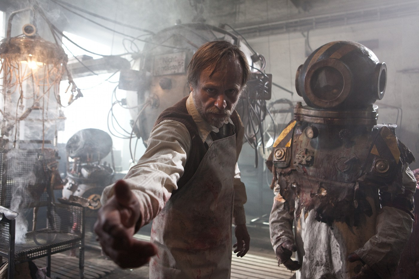 Viktor Frankenstein (Karel Rodin) surrounded by his creations in Frankenstein's Army (2013)