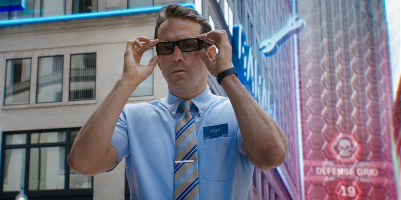 Guy (Ryan Reynolds) puts on his sunglasses in Free Guy (2021)