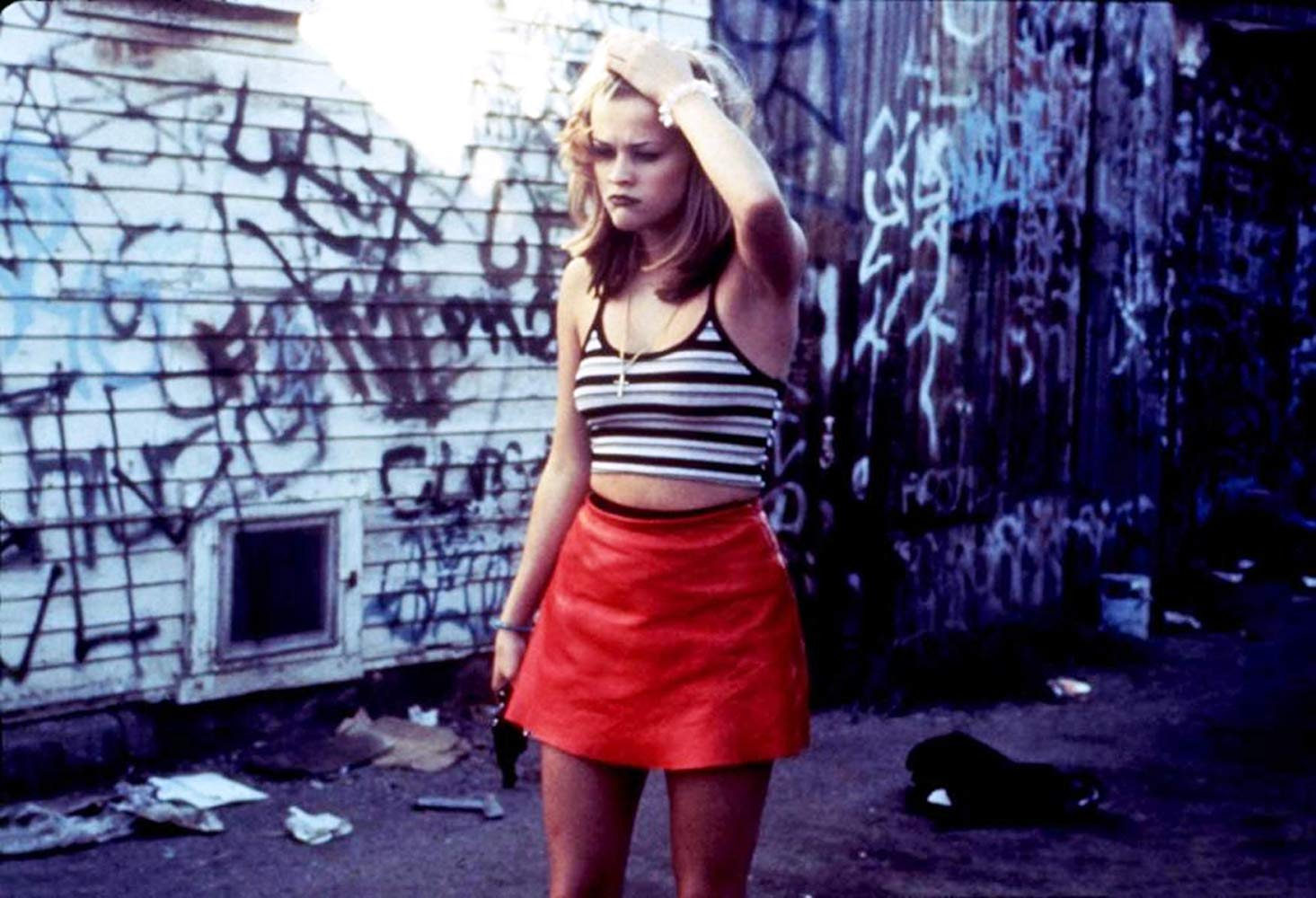 Reese Witherspoon as Vanessa Lutz, a no-longer innocent modern version of Little Red Riding Hood in Freeway (1996)