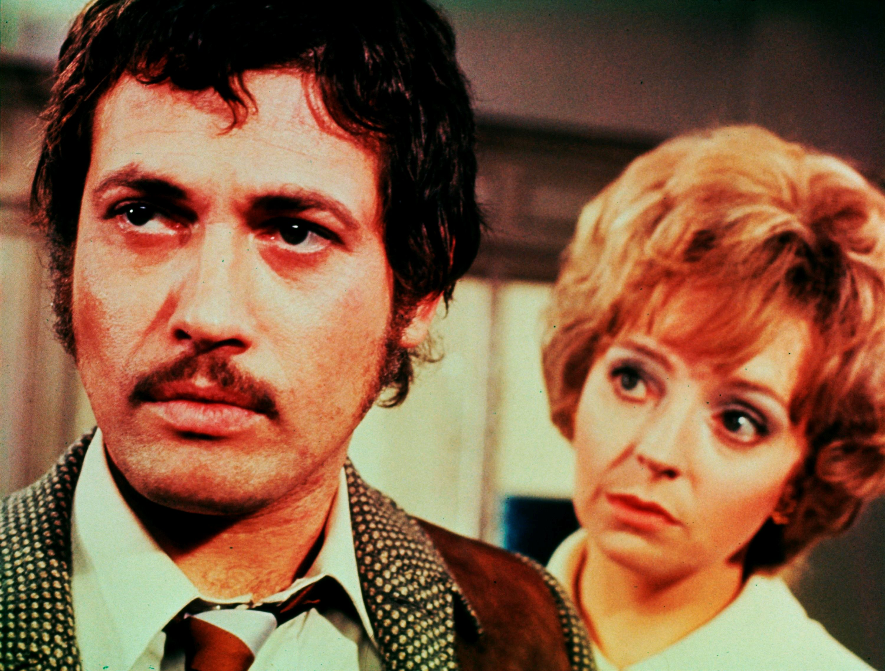 Jon Finch as the man wrongly blamed for a series of killings, along with girlfriend Anna Massey in Frenzy (1972)