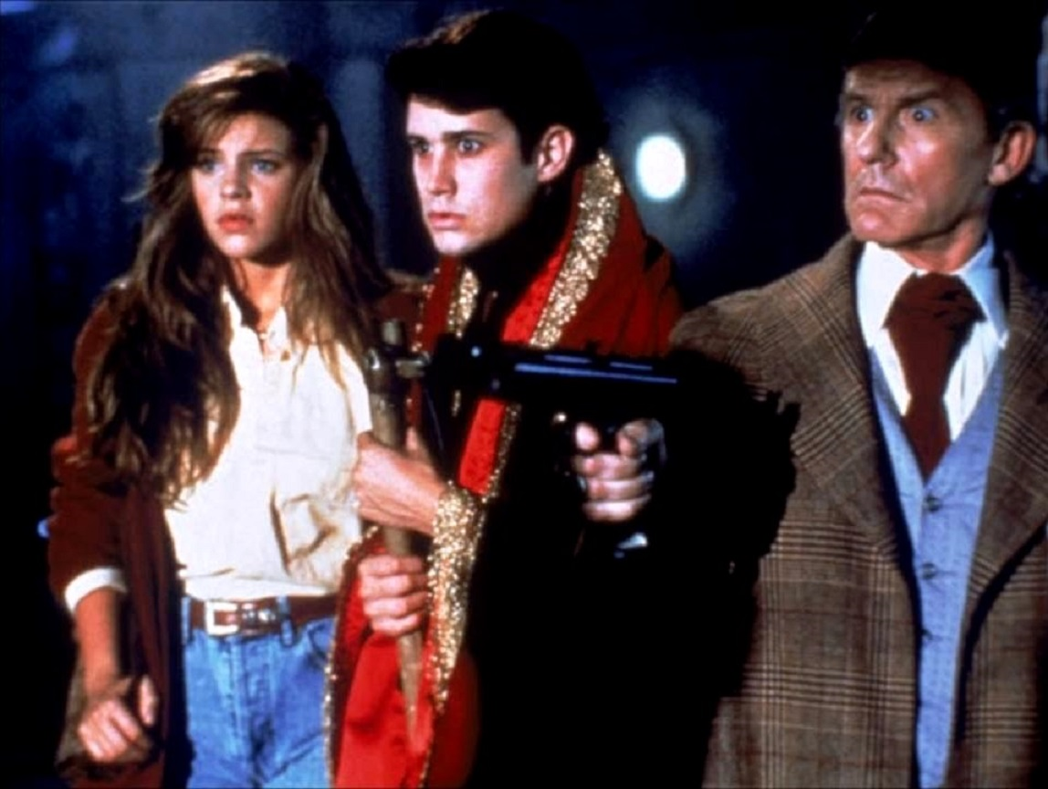 Peter Vincent (Roddy McDowall), Charlie Brewster (William Rgsdale), and new girlfriend Traci Lind in Fright Night Part 2 (1989)