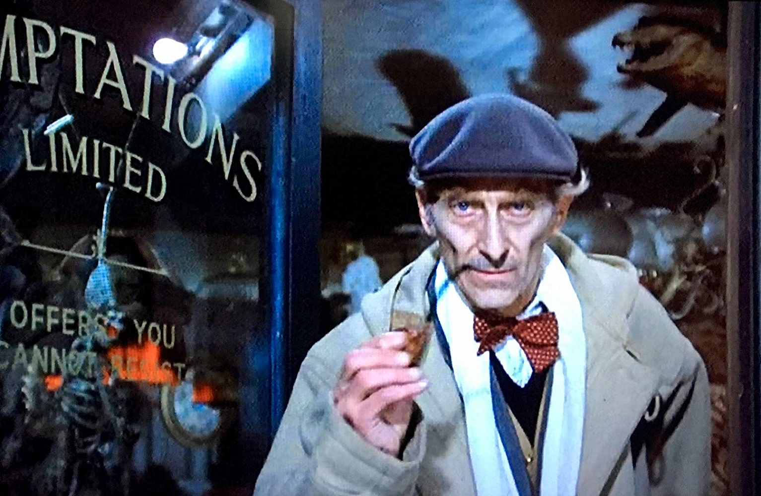 Peter Cushing as the antique store proprietor promises a little 'something extra' with everything he sells in From Beyond the Grave (1974)