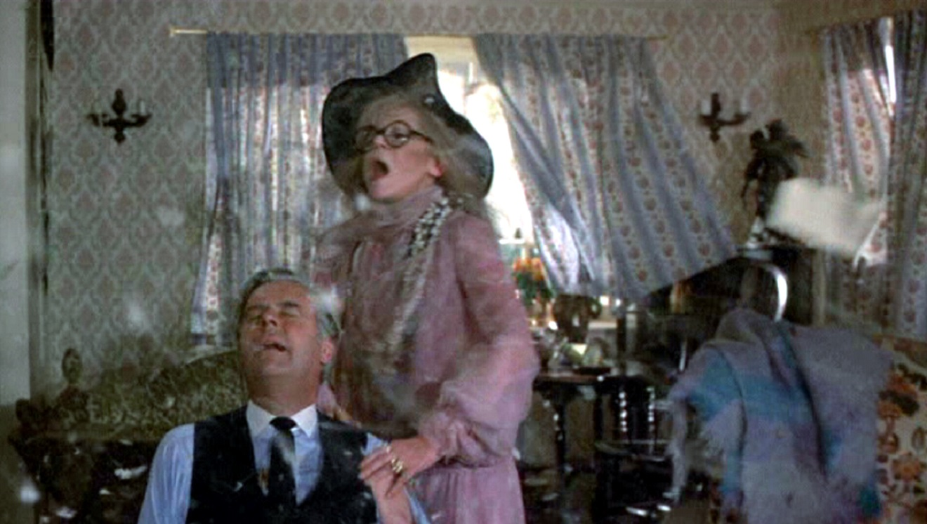Ian Carmichael and daffy exorcist Margaret Leghton in From Beyond the Grave (1974)