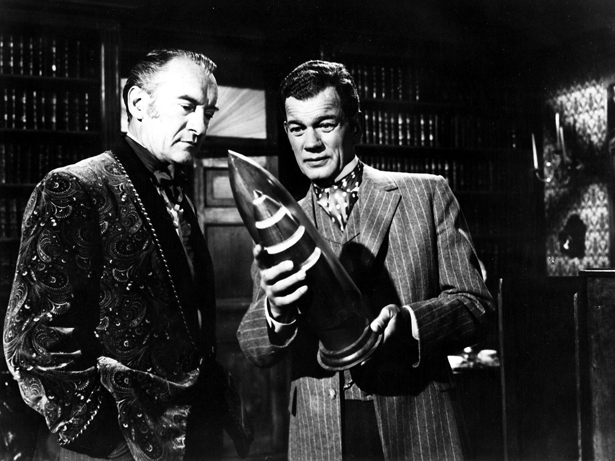 (l to r) Rivals Stuyvesant Nicholl (George Sanders) and Victor Barbicane (Joseph Cotten) plan to launch a rocket in From the Earth to the Moon (1958)