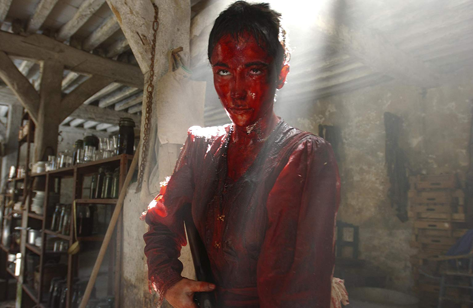 Karina Testa defends herself in the gore-drenched climax of Frontier(s) (2007)