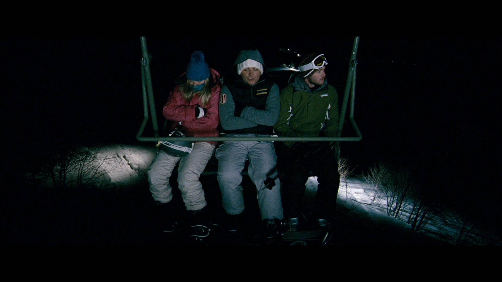 Emma Bell, Kevein Zegers and Shawn Ashmore trapped in mid-air on a ski chairlift in Frozen (2010)