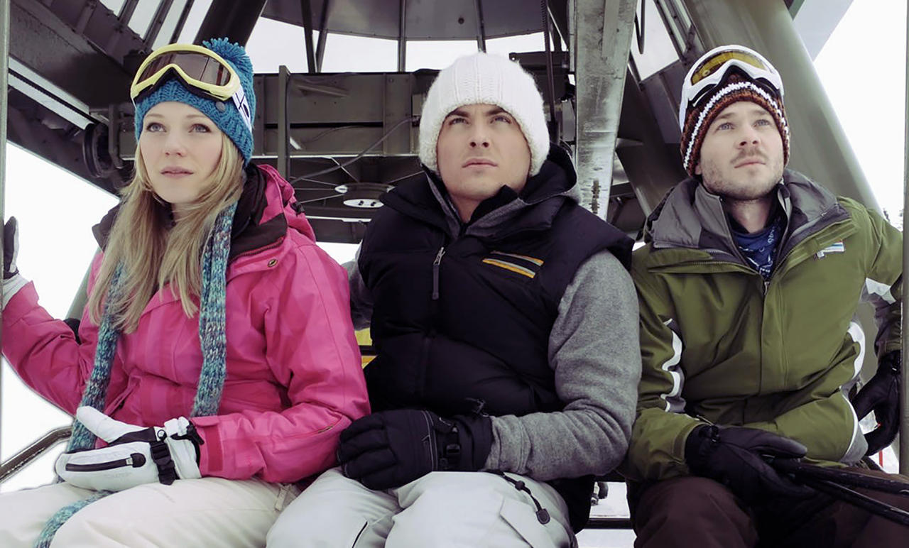 Three friends - (l to r) Emma Bell, Kevein Zegers and Shawn Ashmore - take a ride on a ski chairlift in Frozen (2010)