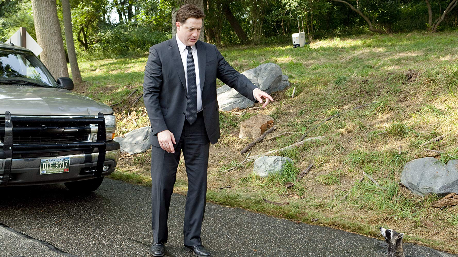 Brendan Fraser and a raccoon in Furry Vengeance (2010)