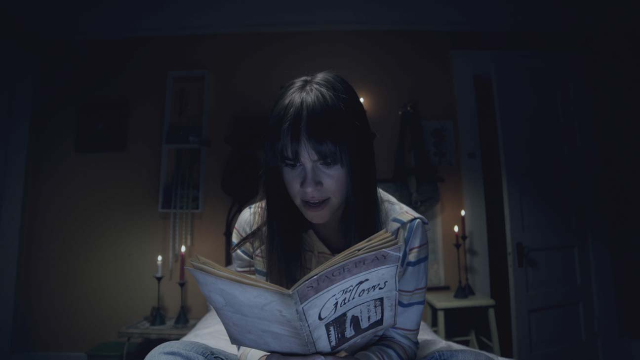 Auna Rue (Ema Horvath) reads a copy of the play in The Gallows Act II (2019)