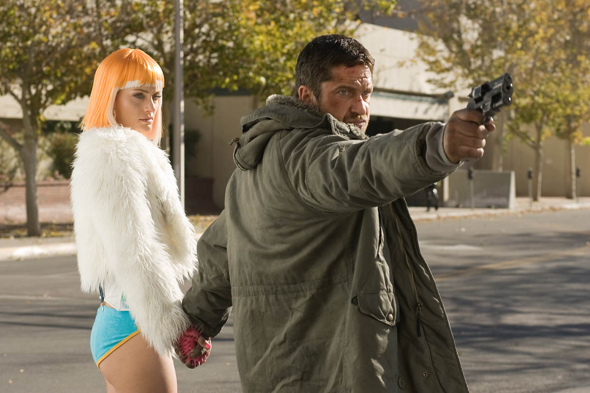 Gerard Butler on the run with Amber Valletta in Gamer (2009)