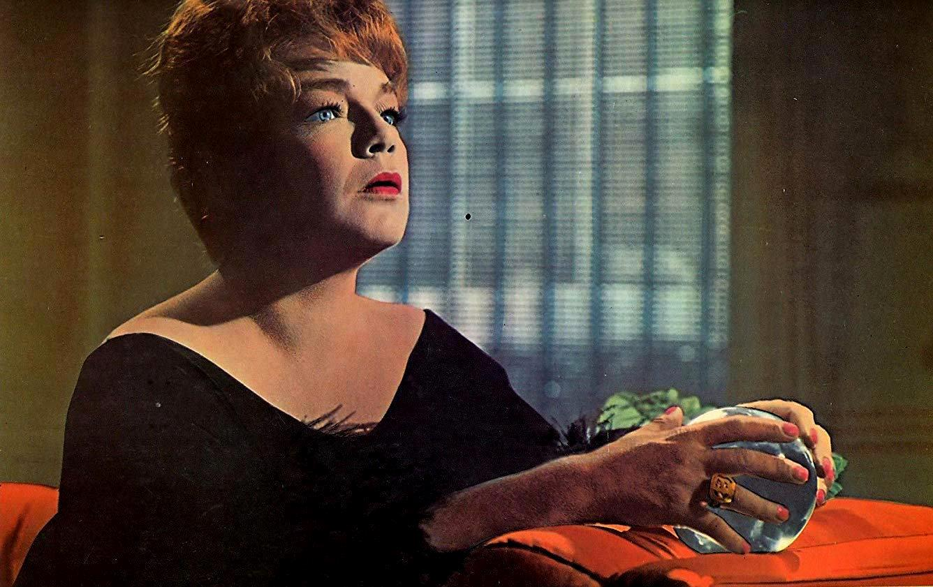 Simone Signoret reads the crystal ball in Games (1967)